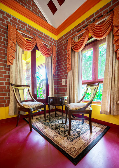 Sip a cup of herbal tea at the sitting area and enjoy the picturesque from the window | Kairali-The Ayurvedic Healing Village